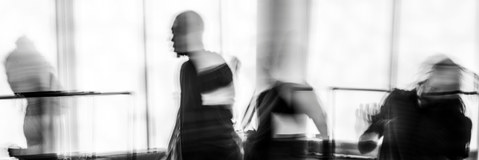 Blurred photo of dancers in a back-lit studio